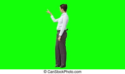 A woman is giving a virtual presentation against a green...