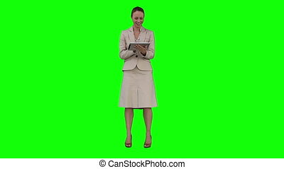 A woman is holding a tablet PC - A smiling woman is holding...