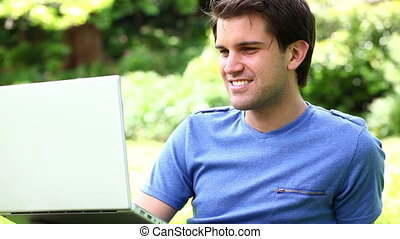 Happy man using a laptop