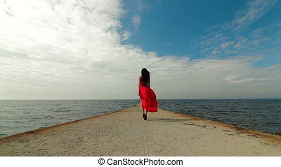 Woman In Red Dress Walks Away - beautiful woman walking down...