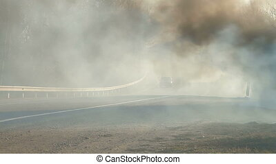 Grass Fire On Roadside - wildfire on the side of the road