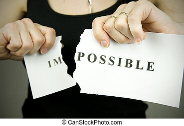 nothing is impossible concept, woman tearing word impossible...