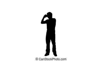 Silhouette man is using a binoculars