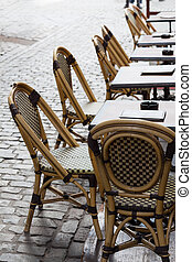 Empty cafe tables in Brussels cobbled square - Row of empty...