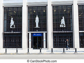 Man walking past national Belgium bank - BRUSSELS, BELGIUM -...