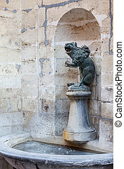 Lion drinking fountain in wall of Town Hall - Ornate...