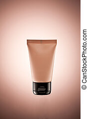 body lotion tube over color gradiented background