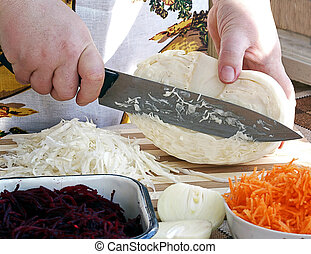 Hands Cutting Vegetables on plate for cooking