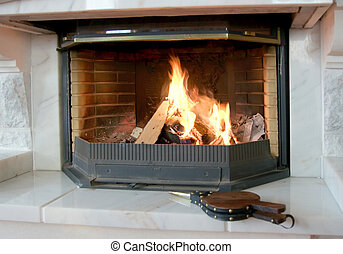 Burning fireplace and bellows - Burning fireplace and the...