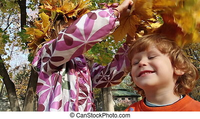 Autumn wreath - The girl wears a wreath on the head boy of...
