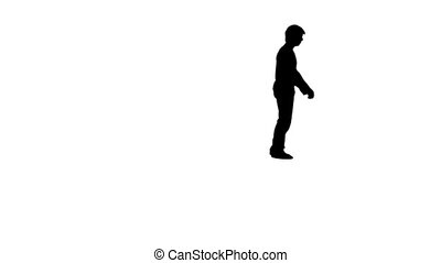 Silhouette of a man doing a backflip