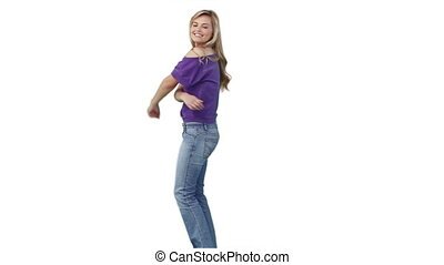 Woman in casual clothing dancing against a white background