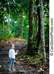 Little girl in a forest - Adorable little girl in a tropical...
