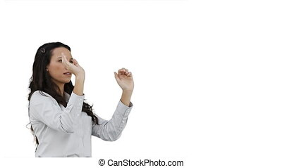 Woman using a virtual interface against a white background