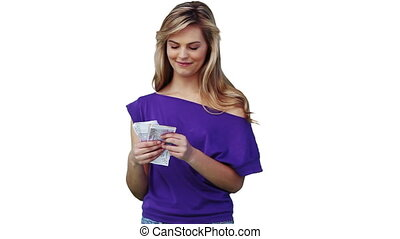 Woman throwing a large amount of cash in the air