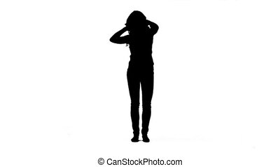 Silhouette of a woman on her own dancing - A silhouette of a...