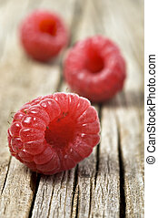 Fresh healthy organic raspberry on wooden background