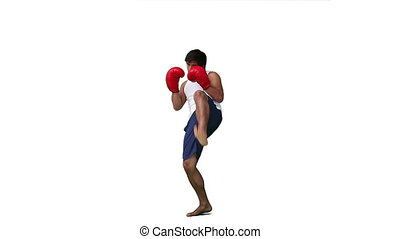 A man is training from kickboxing against a white background