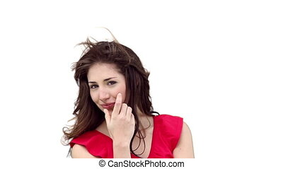 Brunette woman playing with her hair as the wind blows...