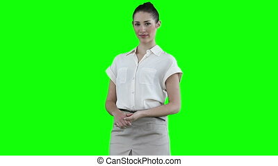 Businesswoman looking to her side against a green background