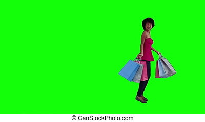 Happy woman is holding shopping bags