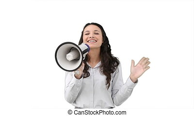 Business woman talking on a megaphone against a white...