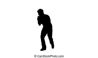 Silhouette energetic man holding a microphone - A silhouette...