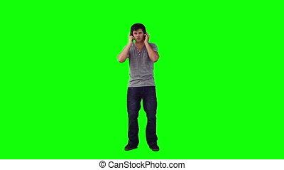 Man with headphones is dancing