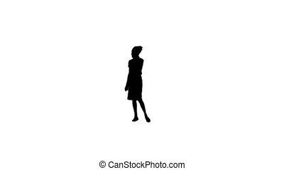 Silhouette of a woman on her mobile phone