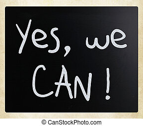 """Yes, we can!"" handwritten with white chalk on a blackboard"