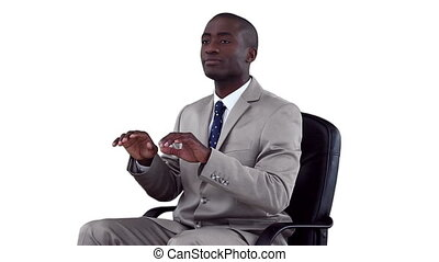 Businessman sitting as he types on a virtual keyboard...