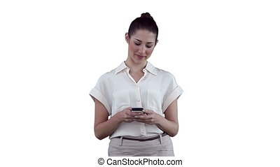 Woman reading a text message before looking to the side