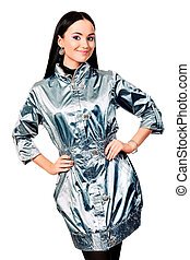 silver raincoat - Fashion model in a coat posing at the...