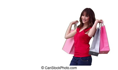 Woman walking across the screen while holding shopping bags