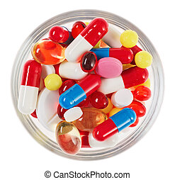 Pills, tablets and drugs heap in glass bowl isolated on...