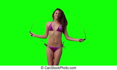 Woman playing with a skipping