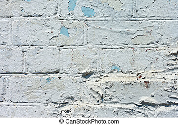 white textured brick wall painted - A white roughly textured...