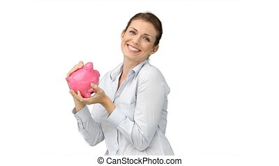 Woman rubbing and kissing her piggy-bank against a white...