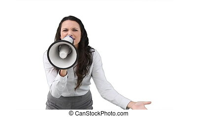 A business woman shouts into a megaphone against a white...