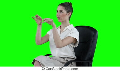 Businesswoman attentively typing on a virtual keyboard