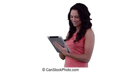 Woman smiling as she uses a tablet pc