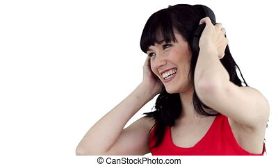 Close up of a woman swaying as she listens to music