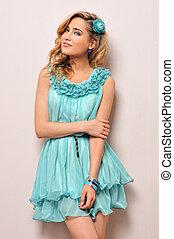 Beautiful blonde in blue dress,