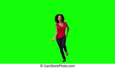 A smiling woman is dancing