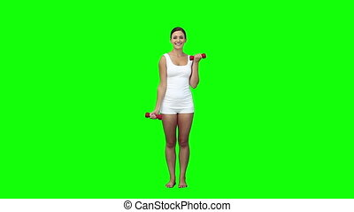 A woman is lifting weights