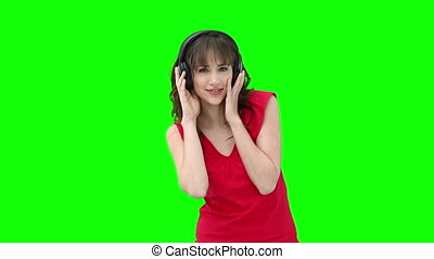 Woman listening using headphones to listen to music