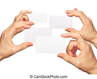 Business cards in hands on white background