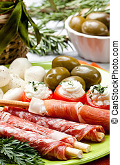 delicatessen appetizers - appetizers with salami,ham,tomato...
