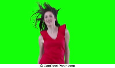 Woman feeling her hair as she is jumping