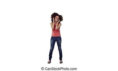 An energetic woman is dancing